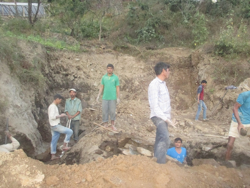 Labourers are digging trenches for foundation to rebuild a house in Melamchi Municaplity.